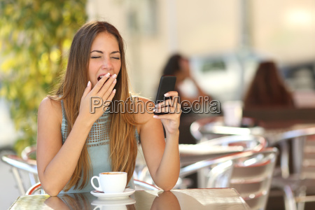 woman yawning while is working at