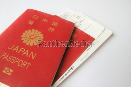 japanese passport and boarding pass