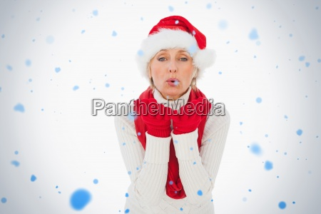 composite image of festive woman blowing