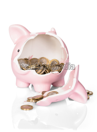 broken piggy bank with money