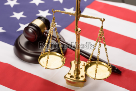 justice scale and wood gavel on