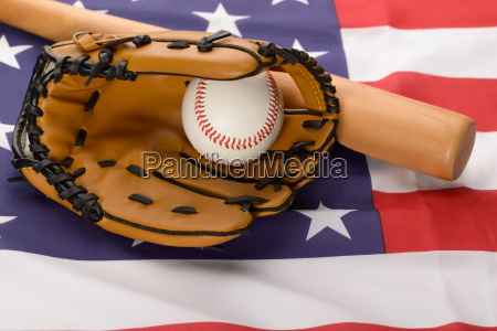 leather glove with baseball and baseball