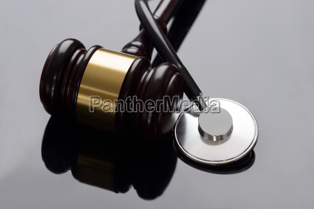 gavel and medical stethoscope