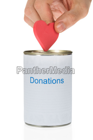 person inserting heart in donation can