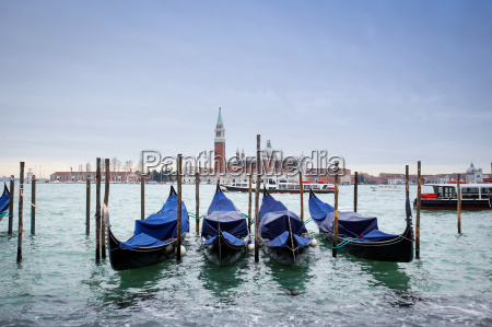 gondolas in water with view of