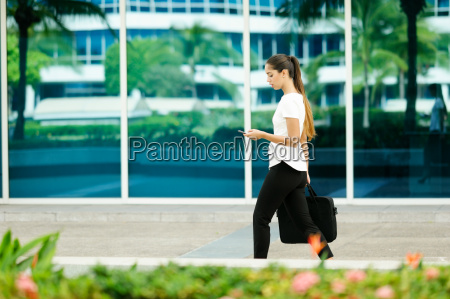 business woman female commuter walking office