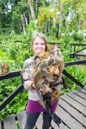 woman and squirrel monkeys