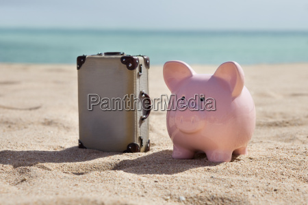 suitcase and piggy bank