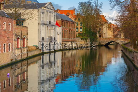 green canal and bridge in bruges
