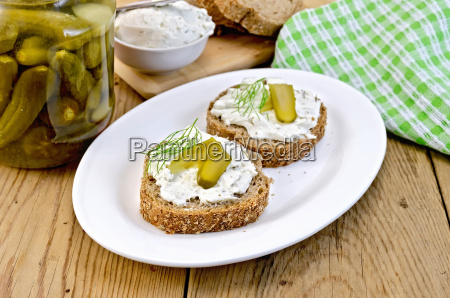 sandwich with cream and pickles on