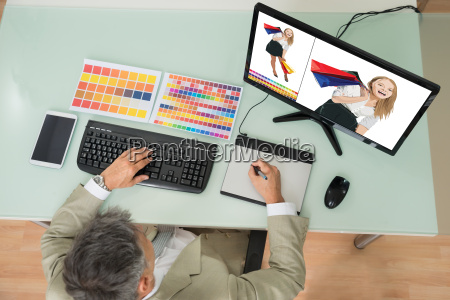 businessman sketching on graphic tablet