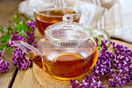 tea of oregano in glass teapot
