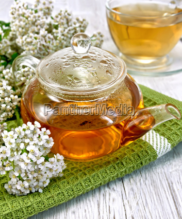 tea with yarrow in glass teapot