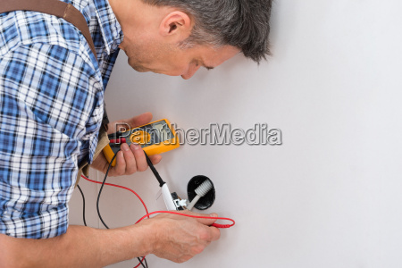 technician checking socket