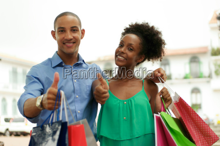portrait african american couple shopping smiling