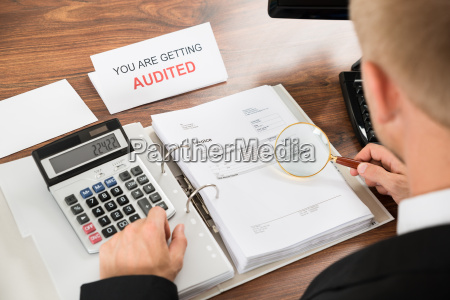 auditor checking invoice