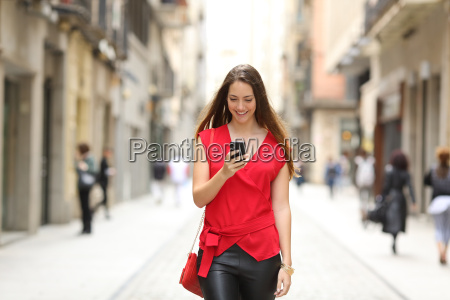 fashion woman walking and using a