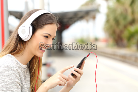 teen girl listening to the music