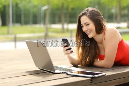 girl using a laptop and smart