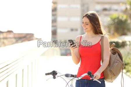 woman using a smart phone walking
