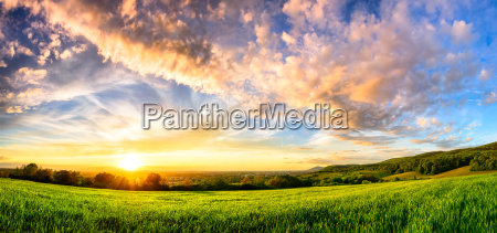panorama of a colourful sunset on