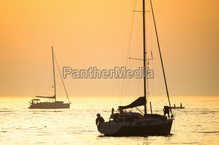 boats in adriatic sea at sunset