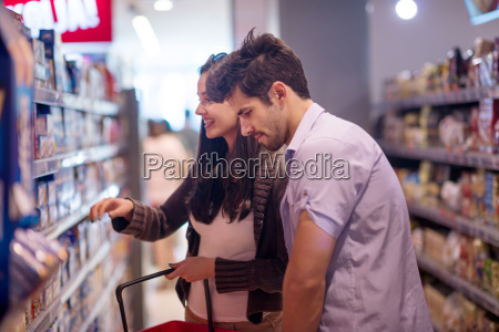 couple shopping in a supermarket
