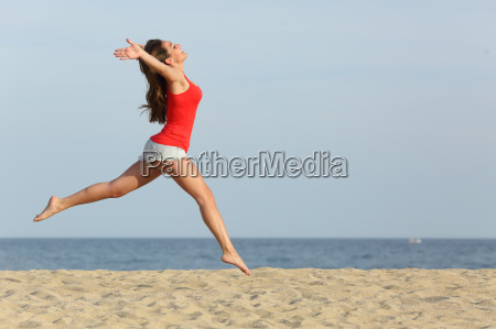 teen girl in red jumping happy