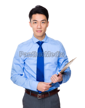 young businessman holding with clipboard