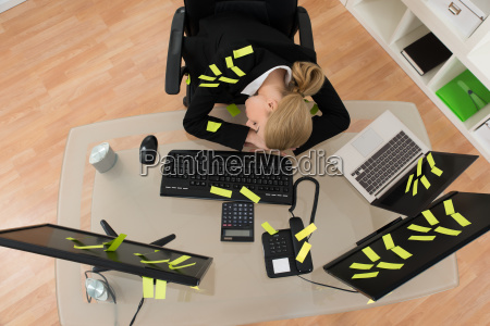 businesswoman with reminder notes sleeping in