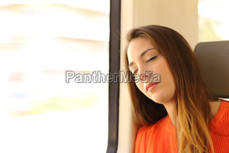 woman sleeping inside a train during