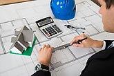 architect working on blueprint