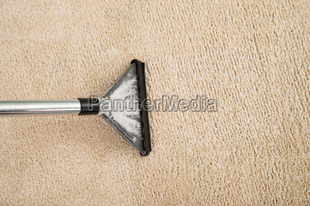 vacuum cleaner over carpet with foam