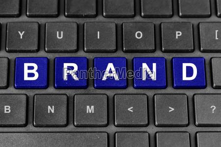 marketing brand tax word on keyboard