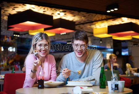 couple having lunch break in shopping