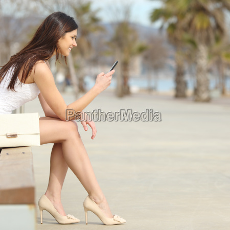 fashion woman using a smartphone in