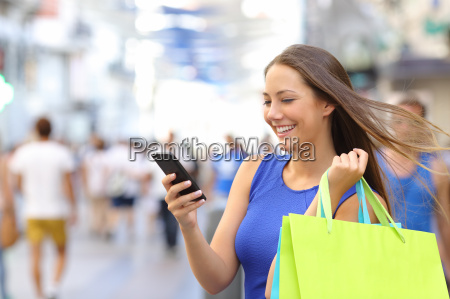 shopper shopping with smartphone in the
