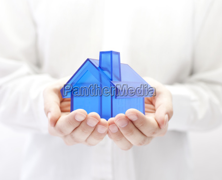 blue house in hands home insurance