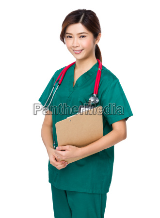 asian young doctor hold with clipboard