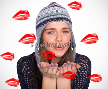 composite image of beautiful woman blowing