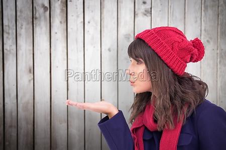 composite image of festive brunette blowing