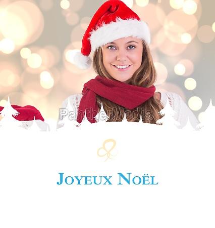 composite image of festive blonde presenting
