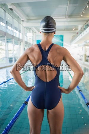 rear view of fit swimmer by