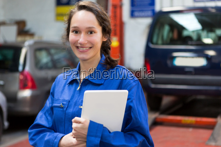 young attractive woman mechanic working at