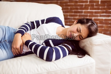 asian woman lying on the couch