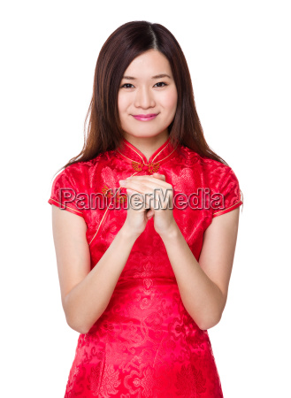 chinese woman with prayer gesture for