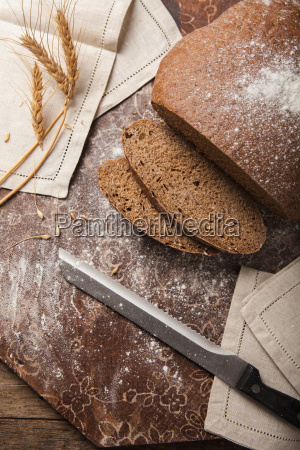 bread rye spikelets on an wooden