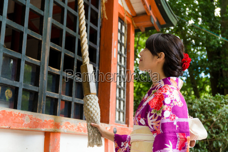 asian woman pull the rope to