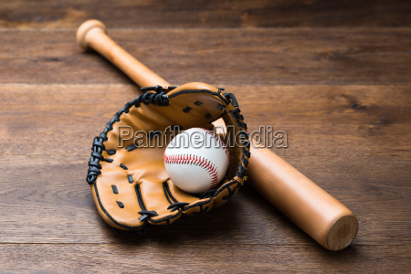 baseball glove and ball with bat