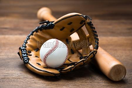 baseball glove and ball with bat